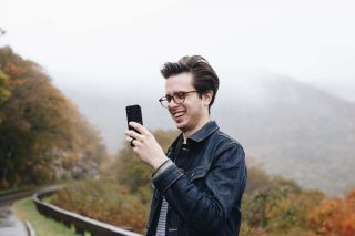 A person taking a photograph using a smartphone.